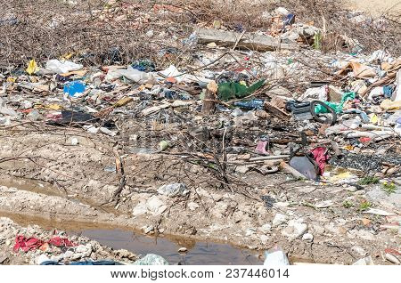 Big Pile Of Junk And Garbage Dumped In The Nature Or Park In The City Polluting The Environment With