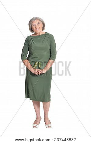 Studio Portrait Of Beautiful Senior Woman In Green Dress Isolated On White Background