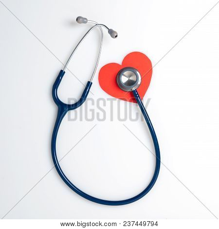 Top View Blue Stethoscope On White Background. For Check Heart Or Health Check Up Concept