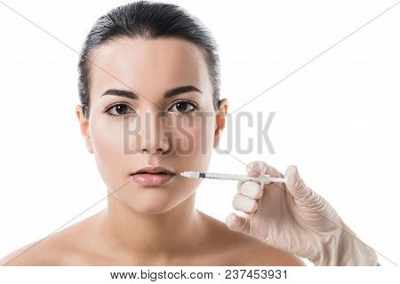 Cropped Image Of Cosmetologist Making Beauty Injection In Girls Lips Isolated On White