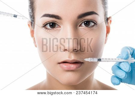Cosmetologists Making Beauty Injections For Beautiful Girl Isolated On White