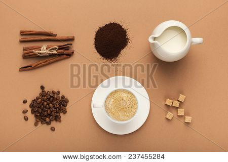 Set Of Roasted Beans And Ground Coffee Piles, Milk Jar, Cup, Refined Brown Sugar And Cinnamon On Bei