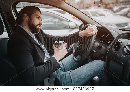 The Driver Going On The Road, Speaking On The Phone, Working With Documents At The Same Time. Busine