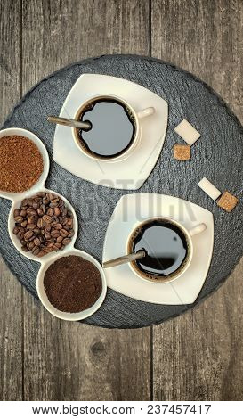 Drinks, Drinking, Energy And Caffeine Concept-two Cups Of Coffee, Coffee Beans, Ground Coffee And In
