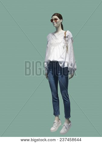 Full-length Female Mannequin Dressed In White Blouse And Blue Jeans, Isolated On White Background. N
