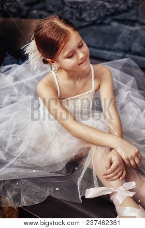 Girl In A White Ball Gown And Shoes, Beautiful Red Hair. Young Theater Actress. Little Prima Ballet.
