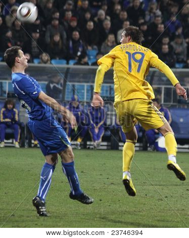 Andriy Yarmolenko Of Ukraine (r) Fights For A Ball With Daniele Gastaldello Of Italy