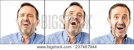 Middle age handsome man closeup having charming smile holding hands on heart wanting to show love and sympathy