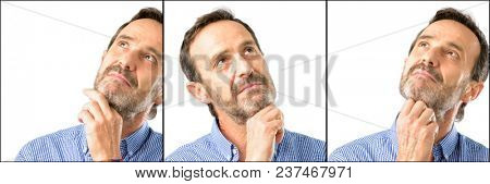 Middle age handsome man closeup thinking and looking up expressing doubt and wonder