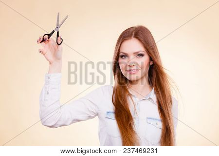 Haircare Concept. Cutting And Trimming. Young Prefessional Female Barber Hairstylist With Scissors.