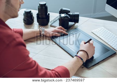 Bearded Man Drawing With Graphic Tablet By Table With Computer