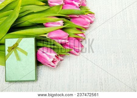 Pink Tulip Bouquet And Small Gift On Light Background, Copy Space