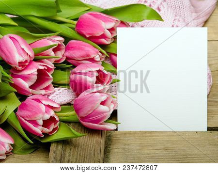Pink Tulip Bouquet And Sheet Of Paper On Wooden Background, Copy Space