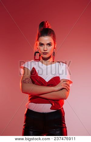 Portrait Of Stylish Woman With Arms Crossed Looking At Camera