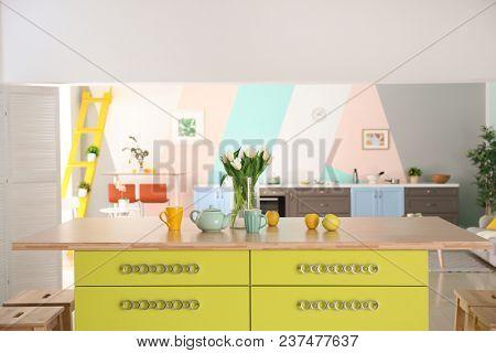 Island with wooden top in modern kitchen interior