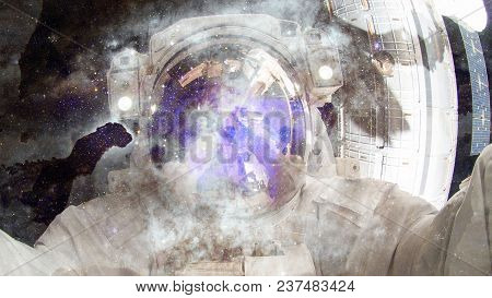 Astronaut In Outer Space. Science Fiction Art. Elements Of This Image Furnished By Nasa.