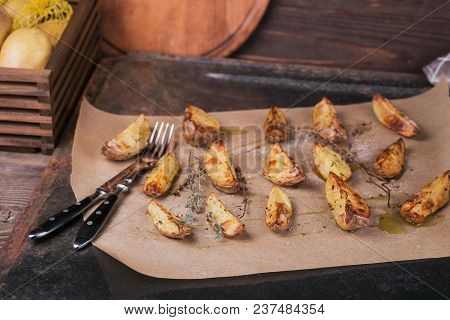 Delicious Baked Potatoes With Herbs And Salt On Parchment Paper