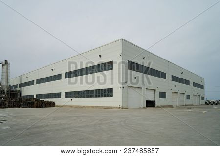 Factory Building Exterior With Warehouse. Industrial Production Of Cement Products. Industry Manufac