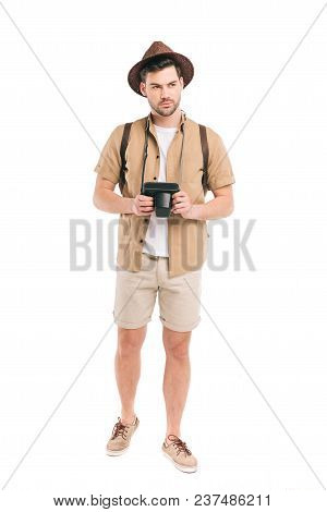 Full Length View Of Handsome Young Traveler Holding Camera And Looking Away Isolated On White