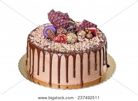 Chocolate Cake With Peanuts. On A White Background