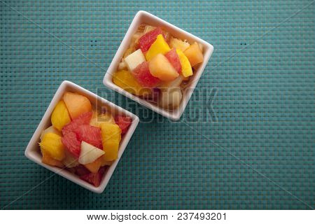Fruit Salad Mix Of Melon, Banana, Watermelon, Orange And Pineapple In A Small Porcelain Bowl, Breakf