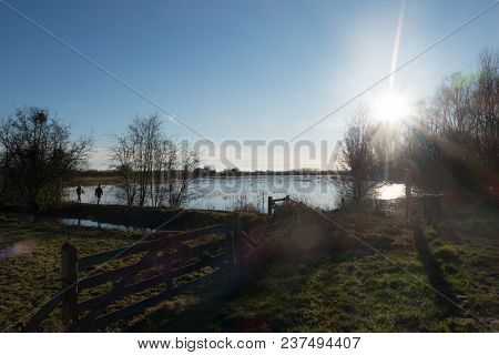 Sun Set At The Overflow Bank Of The Rhine Near Wageningen On A Sunny Cold Winter Day In January