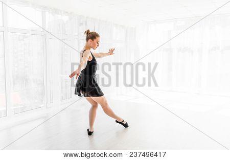 Young ballerina practising ballet moves