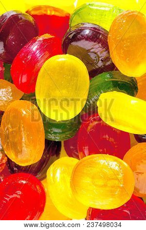 Close Up A Background From Colorful Sweets Of Sugar Candies. Assortment Candies View
