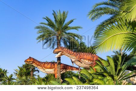 Pattaya,thailand- April 14,2018: Carnotaurus Statue In A Tropical Garden Park Of Suan Nongnooch, Pat