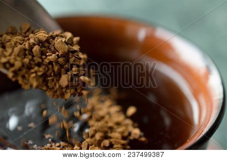 Spoon The Granulated Coffee Into A Cup For Coffee