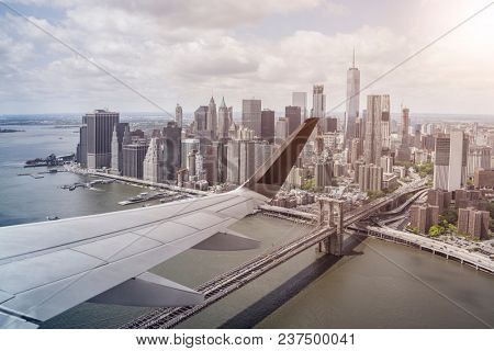 aerial view of lower Manhattan, New York City, from an airplane with wing in front