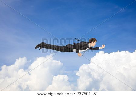 Business Man Flying Above The Cloud  Concept
