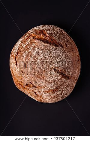 Loaf Of Rye Bread On Black Background. Top View