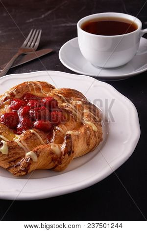 Puff Pastry Tarts With Raspberries And Cup Of Tea On Plate
