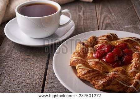 Puff Pastry Tarts With Raspberries On Wooden Background