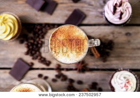 Coffee In Glass On The Wooden Background