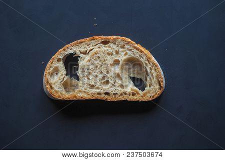 A Piece Of Bread On A Dark Blue Background.