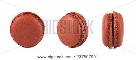 Three Chocolate Macarons Isolated On White Background