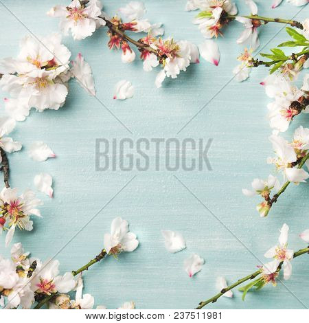 Spring Floral Background, Texture And Wallpaper. Flat-lay Of White Almond Blossom Flowers Over Light
