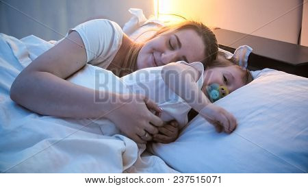 Toddler Boy Sleeping With Mother In Bed At Night