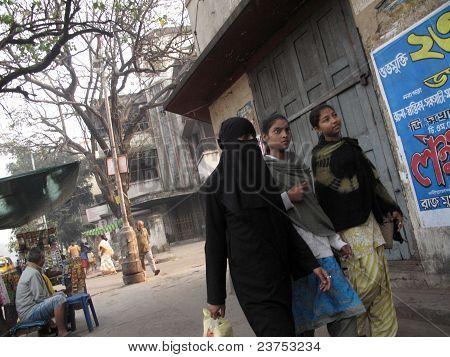 KOLKATA INDIA -JANUARY 23: Streets of Kolkata. Muslim woman in burkha January 23 2009. poster