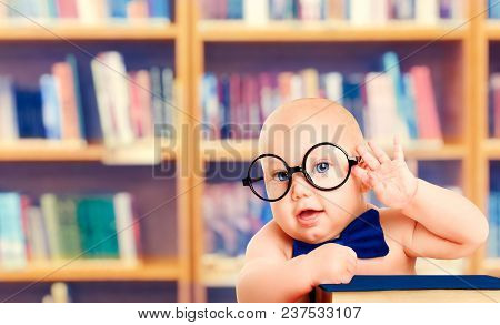 Smart Baby In Glasses With Book, Little Child In School Library, Children Early Education And Develo