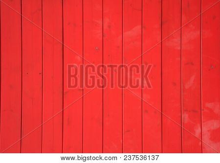 Wooden red background with vertical planks. Vintage empty surface, close up view.