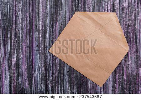 Envelope Of Kraft Paper. Love Letter Envelope. Wooden Background. Envelope With Hearts. Social Netwo