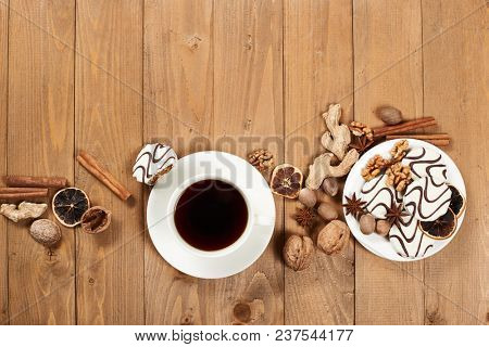 Cup of coffee and cookies on wooden background, spice and decoration, blank space for text, top view, retro style