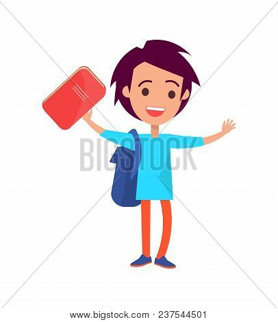 Boy With Medium Length Hair Wearing Blue T-shirt And Backpack Holding Orange Hard Back Book In His H