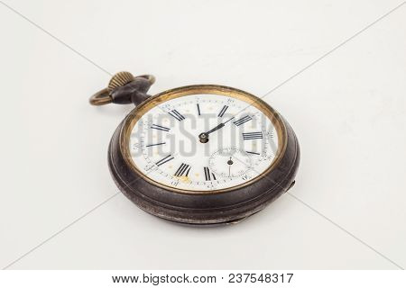 Vintage Pocket Watch On A White Surface