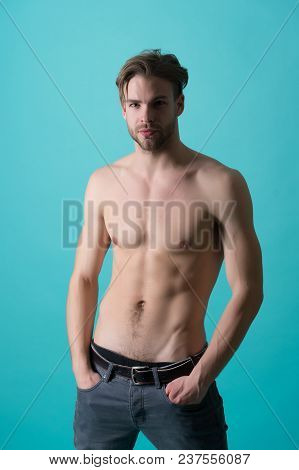 Macho With Sexy Bare Torso In Jeans. Bearded Man With Six Pack And Ab. Sportsman Or Athlete With Sty