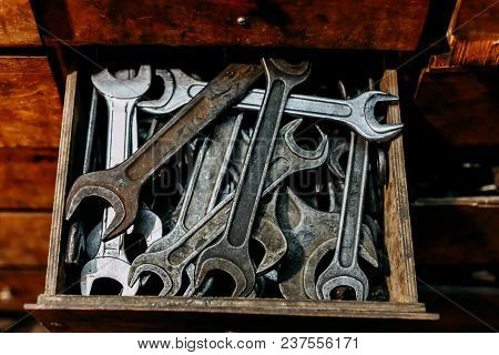 Locking Pliers And Wrench In Tool Box Background