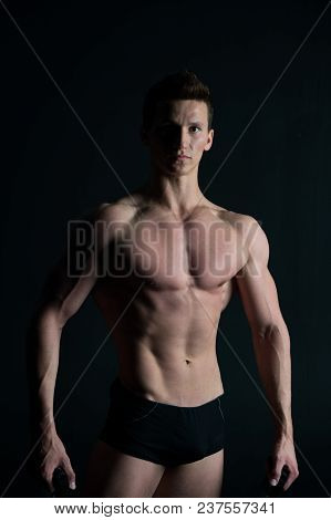 Man Bodybuilder With Fit Body. Macho With Sexy Torso And Chest. Sportsman With Six Pack And Ab Muscl
